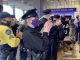 Temple police cheer workers at Temple University Hospital on Wednesday, April 22