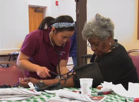 Nursing student helps patient