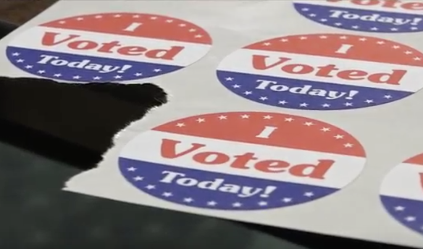 """Picture of a sheet of stickers that say, """"I voted today!"""". The stickers have red, white, and blue colors."""