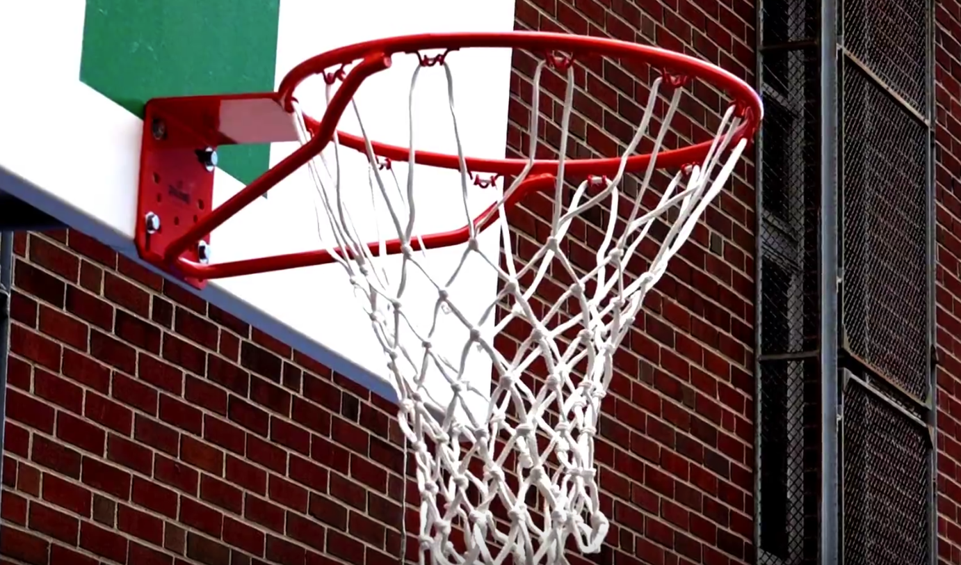 A student raises money for a neighborhood school to get new basketball court netting and rims. He's raised over $1700 with a goal of $2500.